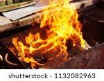 fire brazier on nature bones... | Shutterstock . vector #1132082963