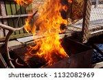 fire brazier on nature bones... | Shutterstock . vector #1132082969