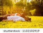 a beautiful young couple laying ... | Shutterstock . vector #1132102919