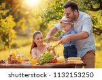happy young family having lunch ... | Shutterstock . vector #1132153250