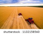 harvesting of wheat in summer.... | Shutterstock . vector #1132158560