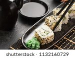 japanese sushi on a rustic dark ... | Shutterstock . vector #1132160729