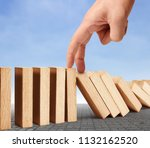 hand stop a dominoes continuous ... | Shutterstock . vector #1132162520
