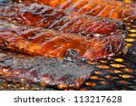 pork ribs on the grill | Shutterstock . vector #113217628