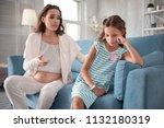 no mood. dark haired little... | Shutterstock . vector #1132180319