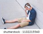 upset teen sitting on the... | Shutterstock . vector #1132215560
