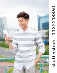 young asian handsome... | Shutterstock . vector #1132218860
