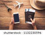 traveler holds passport and... | Shutterstock . vector #1132230596