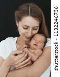 newborn baby lying on the hands ... | Shutterstock . vector #1132246736