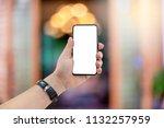 handsome man holding phone. he... | Shutterstock . vector #1132257959