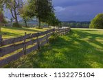 wooden fence at paddock in... | Shutterstock . vector #1132275104