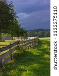 wooden fence at paddock in... | Shutterstock . vector #1132275110