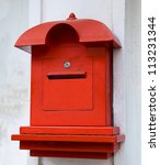 Red Postbox  On White Wall...
