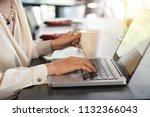 crop side view of hands of... | Shutterstock . vector #1132366043