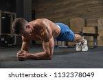 handsome man is exercising in... | Shutterstock . vector #1132378049
