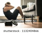 home workout. man doing ab... | Shutterstock . vector #1132404866