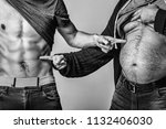fat belly and muscular torso of ... | Shutterstock . vector #1132406030