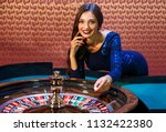 girl dealer spin the spinner.... | Shutterstock . vector #1132422380