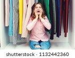 emotional woman choosing her... | Shutterstock . vector #1132442360