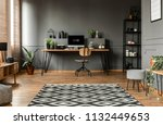 patterned carpet in spacious... | Shutterstock . vector #1132449653