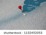 plane fly on map  macro... | Shutterstock . vector #1132452053