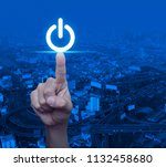 hand pressing power button over ... | Shutterstock . vector #1132458680