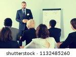 male speaker giving talk on... | Shutterstock . vector #1132485260
