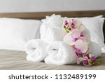 towels and flower on bed in... | Shutterstock . vector #1132489199