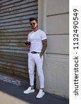 milan   june 17  man with white ... | Shutterstock . vector #1132490549