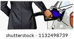 man in suits hand refilling the ... | Shutterstock .eps vector #1132498739