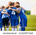boys sports team with coach.... | Shutterstock . vector #1132507160