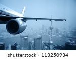 the airplane away from the city ... | Shutterstock . vector #113250934