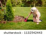 Woman Working In Garden ...