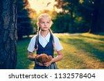 portrait of schoolgirl with... | Shutterstock . vector #1132578404