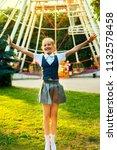 schoolgirl in uniform joyful... | Shutterstock . vector #1132578458