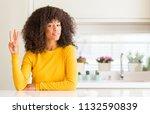 African American Woman Wearing...