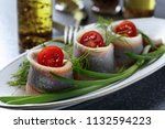 Stock photo fillet of atlantic herring in oil rolls with dill green onion and cherry tomatoes 1132594223