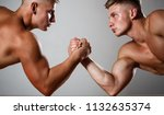 two men arm wrestling. rivalry  ... | Shutterstock . vector #1132635374