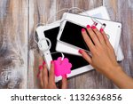 female hand with pink manicure... | Shutterstock . vector #1132636856