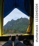 scenic view lying in tent...   Shutterstock . vector #1132640204