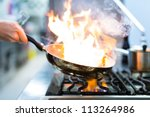 chef in restaurant kitchen at... | Shutterstock . vector #113264986