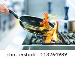 chef in restaurant kitchen at... | Shutterstock . vector #113264989