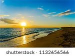 sunset sea shore horizon... | Shutterstock . vector #1132656566