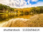 autumn forest river shore... | Shutterstock . vector #1132656614