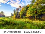 autumn forest river shore in... | Shutterstock . vector #1132656650