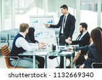 business team gives a... | Shutterstock . vector #1132669340