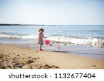 baby girl playing at summer...   Shutterstock . vector #1132677404