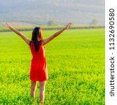beautiful woman enjoying at... | Shutterstock . vector #1132690580