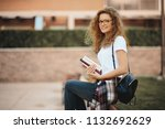 female student sitting in a... | Shutterstock . vector #1132692629