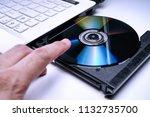 dvd disk on the white laptop... | Shutterstock . vector #1132735700